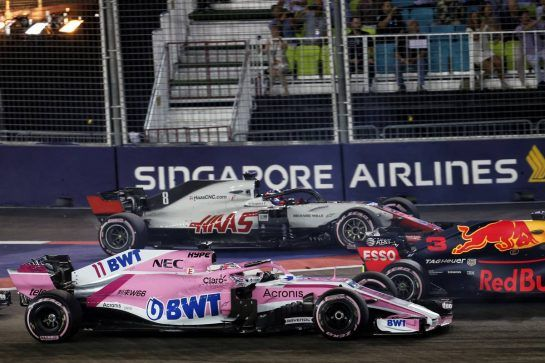 Sergio Perez (MEX) Racing Point Force India F1 VJM11 and Romain Grosjean (FRA) Haas F1 Team VF-18 at the start of the race. 16.09.2018. Formula 1 World Championship, Rd 15, Singapore Grand Prix, Marina Bay Street Circuit, Singapore, Race Day. - www.xpbimages.com, EMail: requests@xpbimages.com - copy of publication required for printed pictures. Every used picture is fee-liable. © Copyright: Batchelor / XPB Images