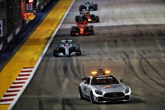 Lewis Hamilton (GBR) Mercedes AMG F1 W09 leads behind the FIA Safety Car. 16.09.2018. Formula 1 World Championship, Rd 15, Singapore Grand Prix, Marina Bay Street Circuit, Singapore, Race Day. - www.xpbimages.com, EMail: requests@xpbimages.com - copy of publication required for printed pictures. Every used picture is fee-liable. © Copyright: Batchelor / XPB Images