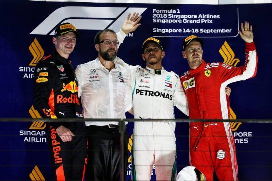 The podium (L to R): Max Verstappen (NLD) Red Bull Racing, second; Lewis Hamilton (GBR) Mercedes AMG F1, race winner; Sebastian Vettel (GER) Ferrari, third. 16.09.2018. Formula 1 World Championship, Rd 15, Singapore Grand Prix, Marina Bay Street Circuit, Singapore, Race Day. - www.xpbimages.com, EMail: requests@xpbimages.com - copy of publication required for printed pictures. Every used picture is fee-liable. © Copyright: Batchelor / XPB Images