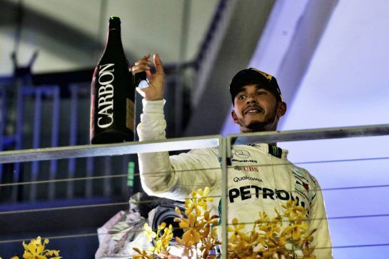 Race winner Lewis Hamilton (GBR) Mercedes AMG F1 celebrates on the podium. 16.09.2018. Formula 1 World Championship, Rd 15, Singapore Grand Prix, Marina Bay Street Circuit, Singapore, Race Day. - www.xpbimages.com, EMail: requests@xpbimages.com - copy of publication required for printed pictures. Every used picture is fee-liable. © Copyright: Moy / XPB Images