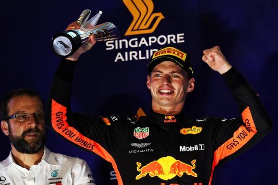 Max Verstappen (NLD) Red Bull Racing celebrates his second position on the podium. 16.09.2018. Formula 1 World Championship, Rd 15, Singapore Grand Prix, Marina Bay Street Circuit, Singapore, Race Day. - www.xpbimages.com, EMail: requests@xpbimages.com - copy of publication required for printed pictures. Every used picture is fee-liable. © Copyright: Photo4 / XPB Images