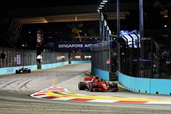 Kimi Raikkonen (FIN) Ferrari SF71H heads into the pits. 16.09.2018. Formula 1 World Championship, Rd 15, Singapore Grand Prix, Marina Bay Street Circuit, Singapore, Race Day. - www.xpbimages.com, EMail: requests@xpbimages.com - copy of publication required for printed pictures. Every used picture is fee-liable. © Copyright: Photo4 / XPB Images