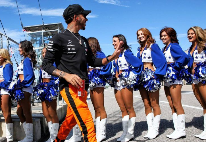 Lewis Hamilton (GBR) Mercedes AMG F1 with the Dallas Cowboys Cheerleaders on the drivers parade.