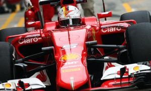 Vettel tries to play down victory chances