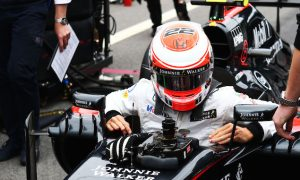 Button working hard to keep McLaren spirits high