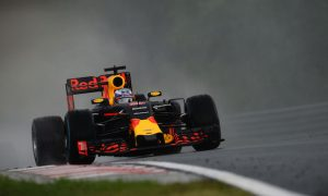 Ricciardo happy to survive chaotic session