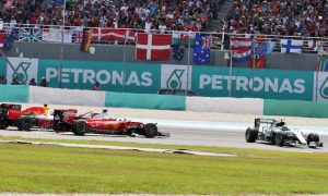 Vettel gets three-place grid penalty for hitting Rosberg