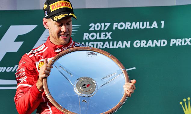 'Surprise' victory a reward for Ferrari passion - Vettel