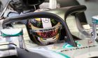 Mercedes' Lewis Hamilton tests the halo cockpit protection device