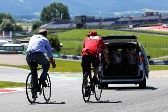 Kimi Raikkonen (FIN) Ferrari rides the circuit on a bicycle. 06.07.2017. Formula 1 World Championship, Rd 9, Austrian Grand Prix, Spielberg, Austria, Preparation Day. - www.xpbimages.com, EMail: requests@xpbimages.com - copy of publication required for printed pictures. Every used picture is fee-liable. © Copyright: Moy / XPB Images