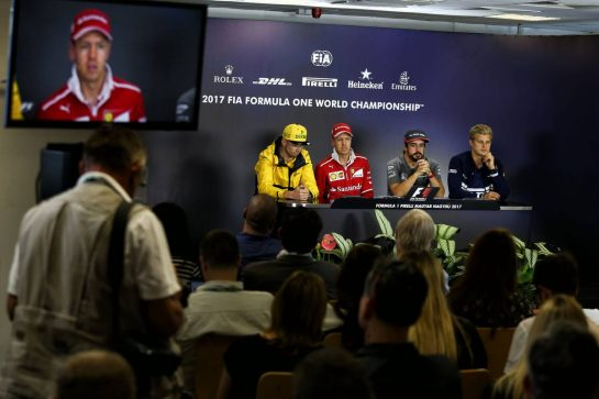 (L to R): Nico Hulkenberg (GER) Renault Sport F1 Team; Sebastian Vettel (GER) Ferrari; Fernando Alonso (ESP) McLaren; and Marcus Ericsson (SWE) Sauber F1 Team, in the FIA Press Conference.