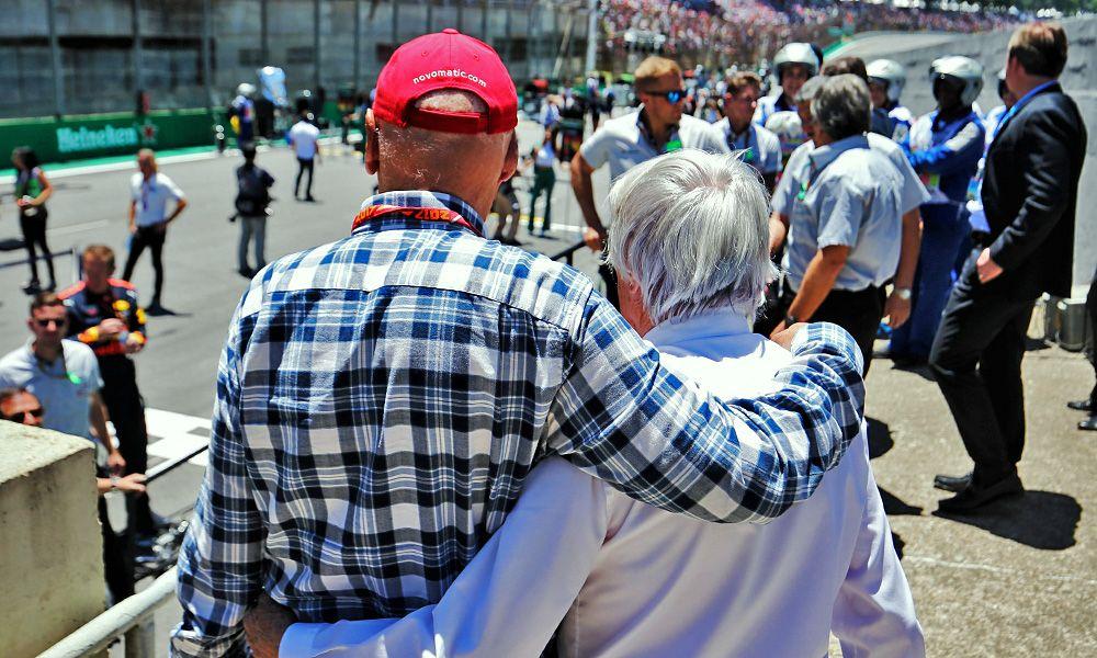 Niki Lauda (Mercedes) and Bernie Ecclestone