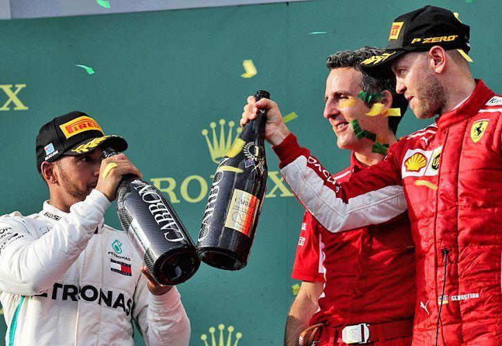 (L to R): Lewis Hamilton (GBR) Mercedes AMG F1 celebrates his second position with race winner Sebastian Vettel (GER) Ferrari.