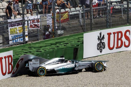 Lewis Hamilton (GBR) Mercedes AMG F1 W05 crashes out in the first section of qualifying. 19.07.2014. Formula 1 World Championship, Rd 10, German Grand Prix, Hockenheim, Germany, Qualifying Day.  - www.xpbimages.com, EMail: requests@xpbimages.com - copy of publication required for printed pictures. Every used picture is fee-liable. © Copyright: Trienitz / XPB Images