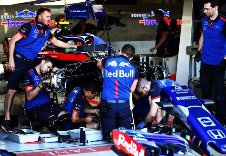 Scuderia Toro Rosso mechanics replace the front suspension on Pierre Gasly's STR13