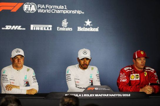 The post qualifying FIA Press Conference (L to R): Valtteri Bottas (FIN) Mercedes AMG F1, second; Lewis Hamilton (GBR) Mercedes AMG F1, pole position; Kimi Raikkonen (FIN) Ferrari, third. 28.07.2018. Formula 1 World Championship, Rd 12, Hungarian Grand Prix, Budapest, Hungary, Qualifying Day.  - www.xpbimages.com, EMail: requests@xpbimages.com - copy of publication required for printed pictures. Every used picture is fee-liable. © Copyright: Bearne / XPB Images