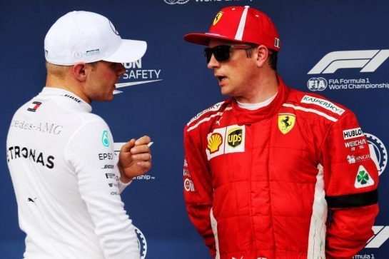 (L to R): Valtteri Bottas (FIN) Mercedes AMG F1 with Kimi Raikkonen (FIN) Ferrari in qualifying parc ferme. 28.07.2018. Formula 1 World Championship, Rd 12, Hungarian Grand Prix, Budapest, Hungary, Qualifying Day. - www.xpbimages.com, EMail: requests@xpbimages.com - copy of publication required for printed pictures. Every used picture is fee-liable. © Copyright: Photo4 / XPB Images