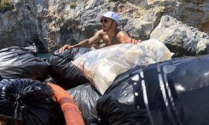 Hamilton gets his hands dirty, slams plastic waste