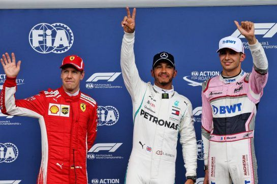 Qualifying top three in parc ferme (L to R): Sebastian Vettel (GER) Ferrari, second; Lewis Hamilton (GBR) Mercedes AMG F1, pole position; Esteban Ocon (FRA) Racing Point Force India F1 Team, third. 25.08.2018. Formula 1 World Championship, Rd 13, Belgian Grand Prix, Spa Francorchamps, Belgium, Qualifying Day. - www.xpbimages.com, EMail: requests@xpbimages.com - copy of publication required for printed pictures. Every used picture is fee-liable. © Copyright: Batchelor / XPB Images