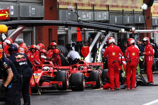 Sebastian Vettel (GER) Ferrari SF71H and Kimi Raikkonen (FIN) Ferrari SF71H in the pits. 25.08.2018. Formula 1 World Championship, Rd 13, Belgian Grand Prix, Spa Francorchamps, Belgium, Qualifying Day. - www.xpbimages.com, EMail: requests@xpbimages.com - copy of publication required for printed pictures. Every used picture is fee-liable. © Copyright: Batchelor / XPB Images