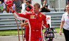 Pole sitter Kimi Raikkonen (FIN) Ferrari in qualifying parc ferme.