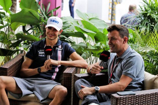 Esteban Ocon (FRA) Racing Point Force India F1 Team with Will Buxton (GBR) F1 Digital Presenter. 15.09.2018. Formula 1 World Championship, Rd 15, Singapore Grand Prix, Marina Bay Street Circuit, Singapore, Qualifying Day. - www.xpbimages.com, EMail: requests@xpbimages.com - copy of publication required for printed pictures. Every used picture is fee-liable. © Copyright: Moy / XPB Images