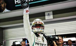 Hamilton seizes sizzling Singapore pole as Ferrari falters