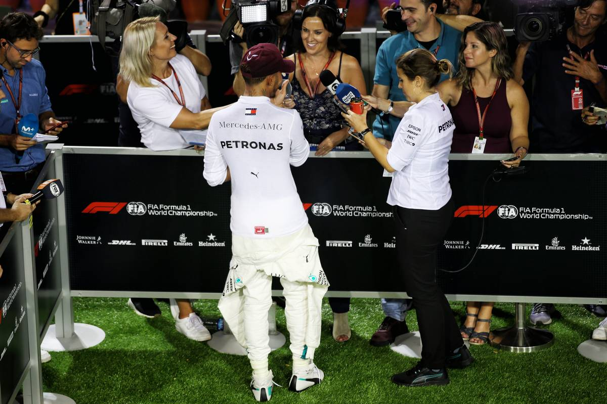 Lewis Hamilton (GBR) Mercedes AMG F1 with the media.