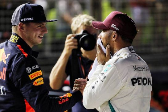 (L to R): second placed Max Verstappen (NLD) Red Bull Racing congratulates Lewis Hamilton (GBR) Mercedes AMG F1 on his pole position in qualifying parc ferme. 15.09.2018. Formula 1 World Championship, Rd 15, Singapore Grand Prix, Marina Bay Street Circuit, Singapore, Qualifying Day. - www.xpbimages.com, EMail: requests@xpbimages.com - copy of publication required for printed pictures. Every used picture is fee-liable. © Copyright: Photo4 / XPB Images