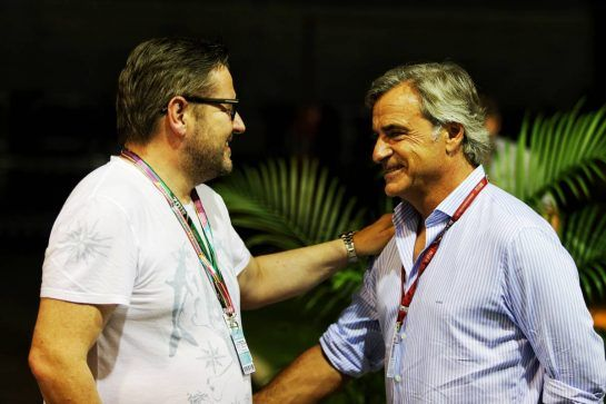 (L to R): Bertrand Brillois (FRA) Driver Manager of Esteban Ocon (FRA) Racing Point Force India F1 Team with Carlos Sainz Jr (ESP) Renault Sport F1 Team. 15.09.2018. Formula 1 World Championship, Rd 15, Singapore Grand Prix, Marina Bay Street Circuit, Singapore, Qualifying Day. - www.xpbimages.com, EMail: requests@xpbimages.com - copy of publication required for printed pictures. Every used picture is fee-liable. © Copyright: Moy / XPB Images