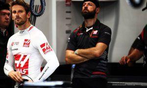 Grosjean on song in Singapore as Magnussen struggles