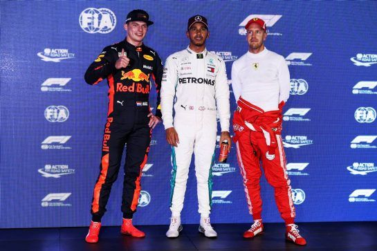 Qualifying top three in parc ferme (L to R): Max Verstappen (NLD) Red Bull Racing, second; Lewis Hamilton (GBR) Mercedes AMG F1, pole position; Sebastian Vettel (GER) Ferrari, third. 15.09.2018. Formula 1 World Championship, Rd 15, Singapore Grand Prix, Marina Bay Street Circuit, Singapore, Qualifying Day. - www.xpbimages.com, EMail: requests@xpbimages.com - copy of publication required for printed pictures. Every used picture is fee-liable. © Copyright: Batchelor / XPB Images