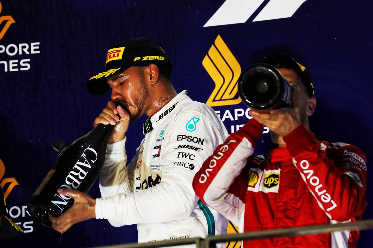 Race winner Lewis Hamilton (GBR) Mercedes AMG F1 celebrates on the podium with third placed Sebastian Vettel (GER) Ferrari. 16.09.2018.