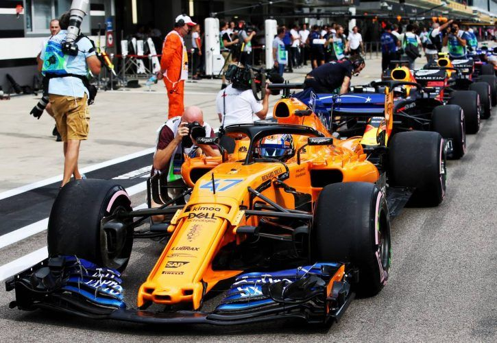 Lando Norris (GBR) McLaren MCL33 Test Driver leads drivers queueing at pit exit who will have grid penalties for Sunday's race.