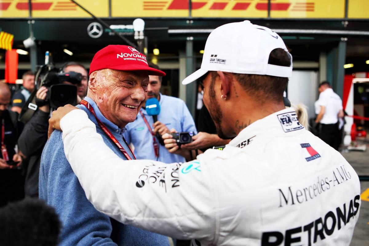 Lewis Hamilton (GBR) Mercedes AMG F1 celebrates his pole position with Niki Lauda (AUT) Mercedes Non-Executive Chairman.