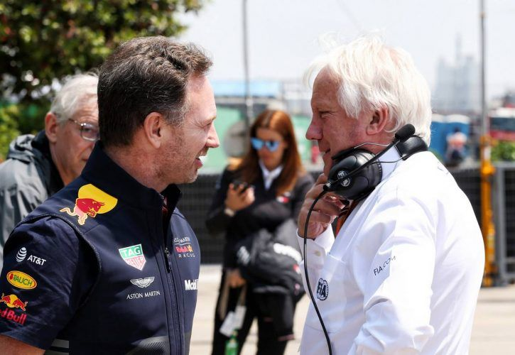 Christian Horner (GBR) Red Bull Racing Team Principal with Charlie Whiting (GBR) FIA Delegate.