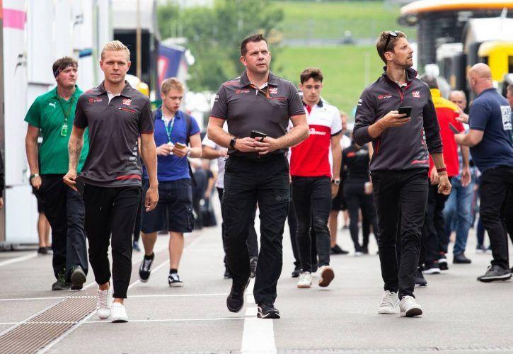 Kevin Magnussen (DEN) Haas F1 Team and team mate Romain Grosjean (FRA) Haas F1 Team