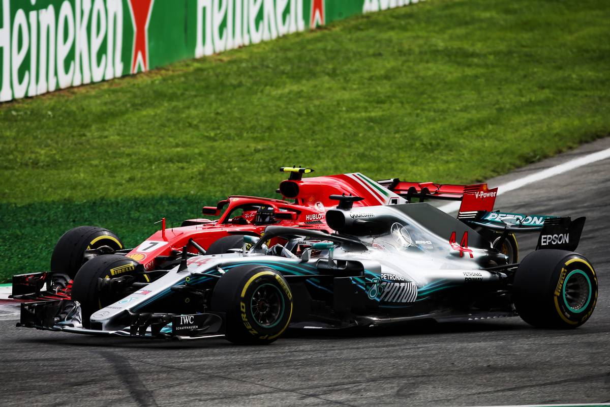 Kimi Raikkonen (FIN) Ferrari SF71H and Lewis Hamilton (GBR) Mercedes