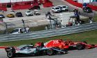Kimi Raikkonen (FIN) Ferrari SF71H leads Lewis Hamilton (GBR) Mercedes AMG F1 W09 at the start of the United States Grand Prix