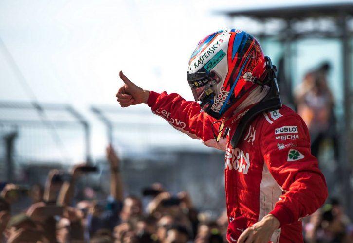 Race winner Kimi Raikkonen (FIN) Ferrari celebrates in parc ferme.
