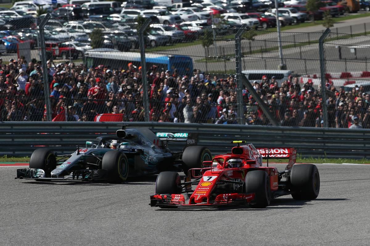Kimi Raikkonen (FIN) Ferrari SF71H leads Lewis Hamilton