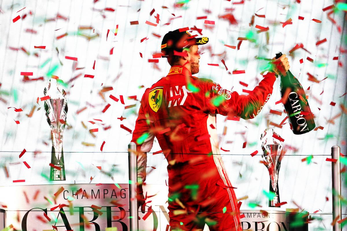 Sebastian Vettel (GER) Ferrari celebrates his second position on the podium.