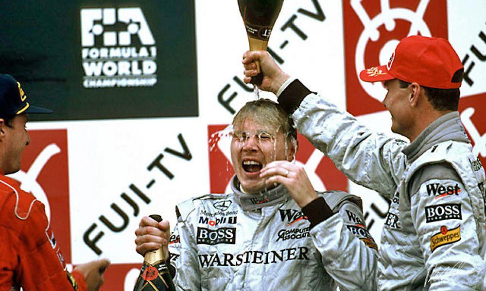 Mika Hakkinen celebrates winning the 1998 world championship after victory in the Japanese Grand Prix in Suzuka.