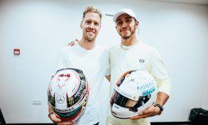 Hamilton and Vettel cap off season with helmet swap