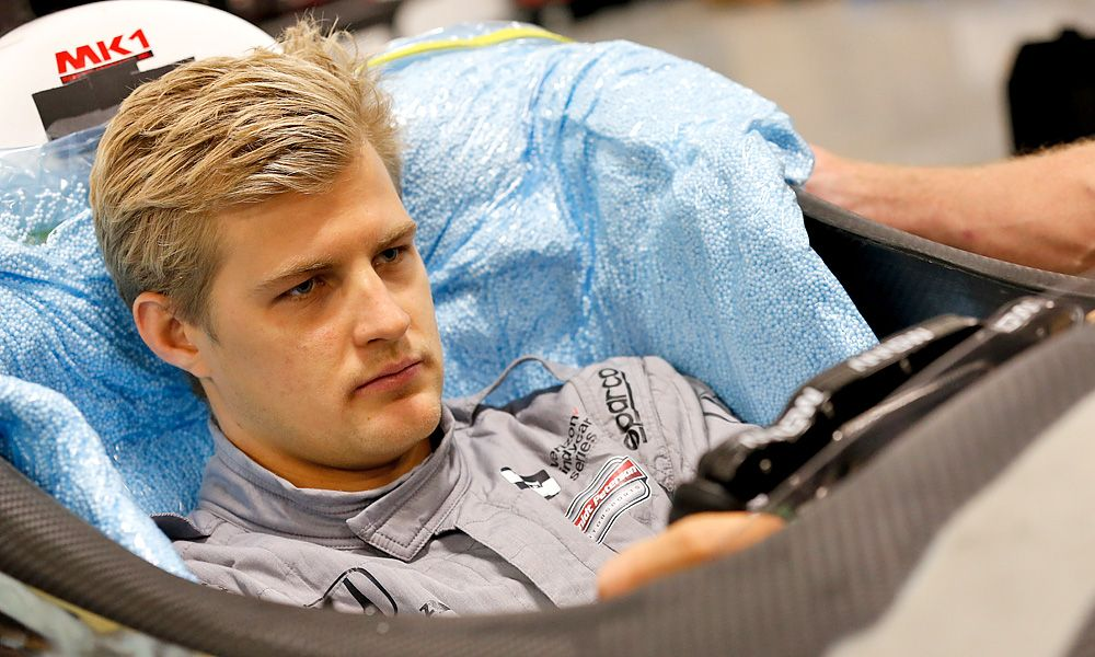 Marcus Ericsson sits in his Dallara IR-12 machine for his seat fit