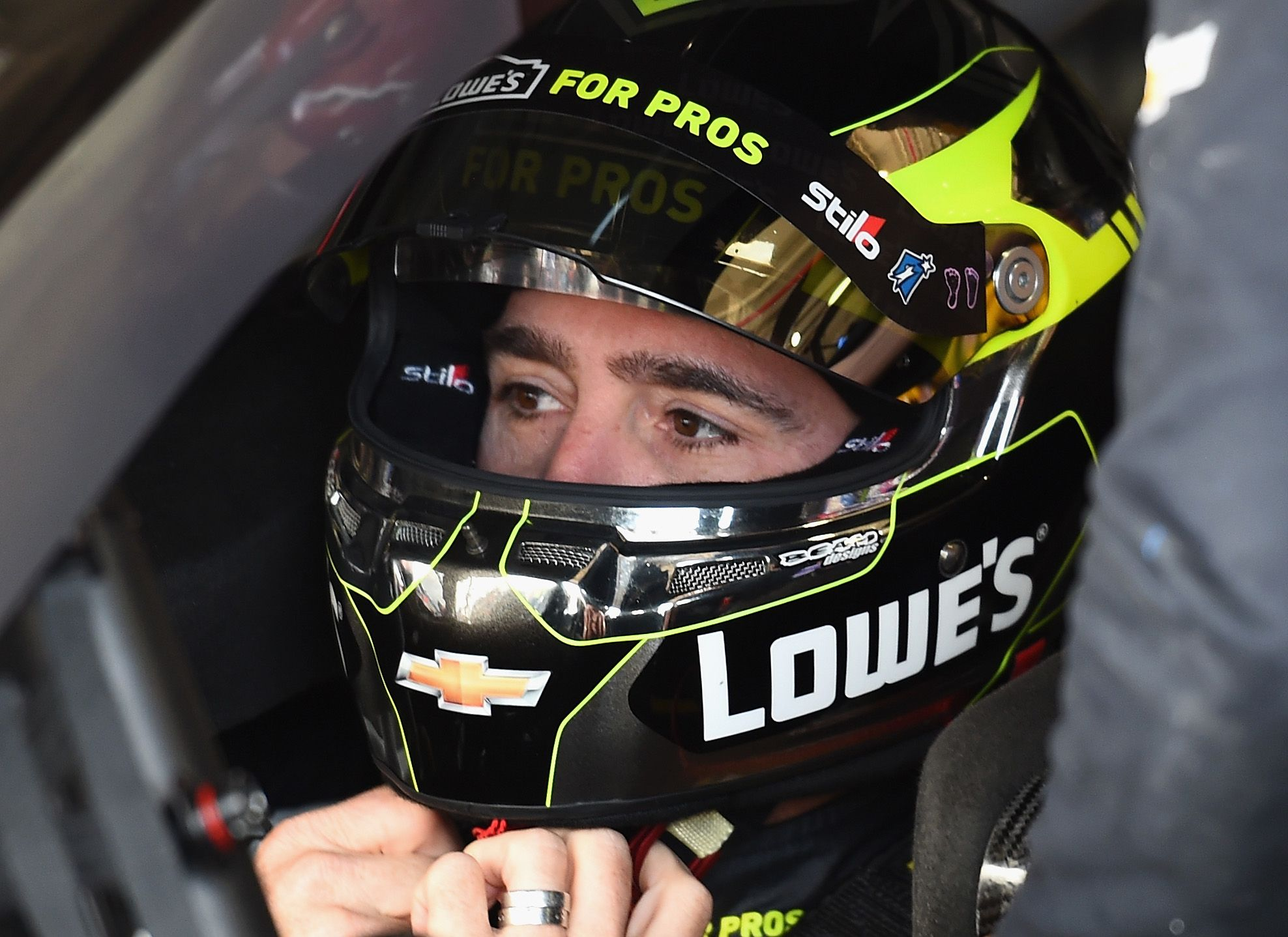 Jimmie Johnson, driver of the #48 Lowe's for Pros Chevrolet, straps on his helmet