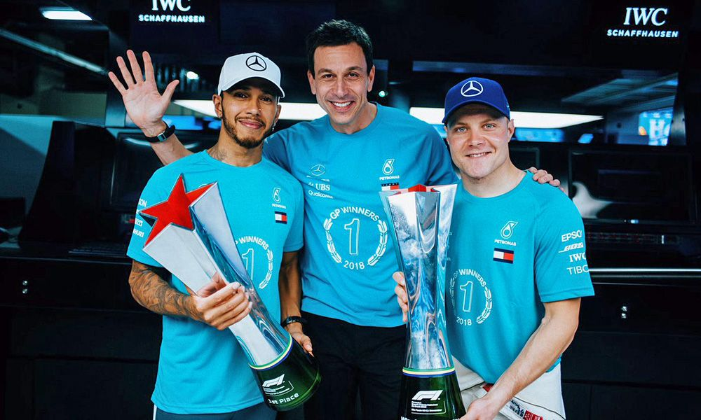 Toto Wolff, Lewis Hamilton and Valtteri Bottas celebrate title success in Brazil in 2018.