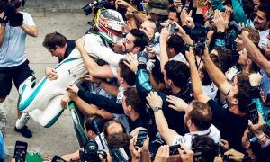 Mercedes celebrations break down the barriers… literally!