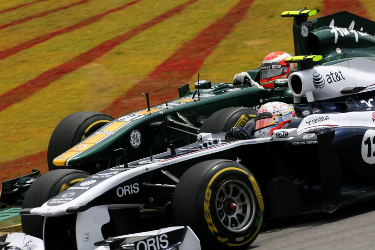 27.11.2011 Interlargos, Brazil, Jarno Trulli (ITA), Team Lotus and Pastor Maldonado (VEN), Williams F1 Team