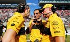 Renault seniro management discuss strategy on the grid.
